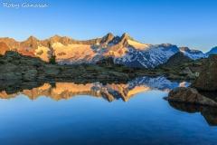 Cima di Vazzeda cima di Rosso monte Sissone riflesse in una pozza